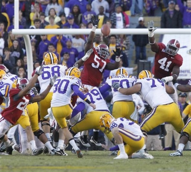 LSU linebacker Kelvin Sheppard (11) intercepts a pass by Alabama quarterback Greg McElroy during the first quarter of their NCAA college football game in Baton Rouge, La., Saturday, Nov. 6, 2010. (AP Photo/Gerald Herbert)