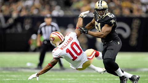 Kyle Williams #10 of the San Francisco 49ers is knocked down by Jonathan Vilma #51 of the New Orleans Saints during a game at the Mercedes-Benz Superdome on November 25, 2012 in New Orleans, Louisiana. (Photo by Stacy Revere/Getty Images)