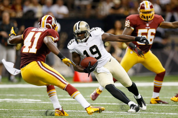 NEW ORLEANS, LA - SEPTEMBER 09:   Devery Henderson #19 of the New Orleans Saints tries to avoid a tackle by  Madieu Williams #41 of the Washington Redskins during the season opener at Mercedes-Benz Superdome on September 9, 2012 in New Orleans, Louisiana.  The Redskins defeated the Saints 40-32.   (Photo by Chris Graythen/Getty Images)