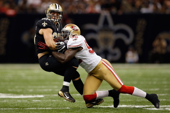 NEW ORLEANS, LA - NOVEMBER 25:  Jimmy Graham #80 of the New Orleans Saints is tackled by  Patrick Willis #52 of the San Francisco 49ers at The Mercedes-Benz Superdome on November 25, 2012 in New Orleans, Louisiana.  (Photo by Chris Graythen/Getty Images)