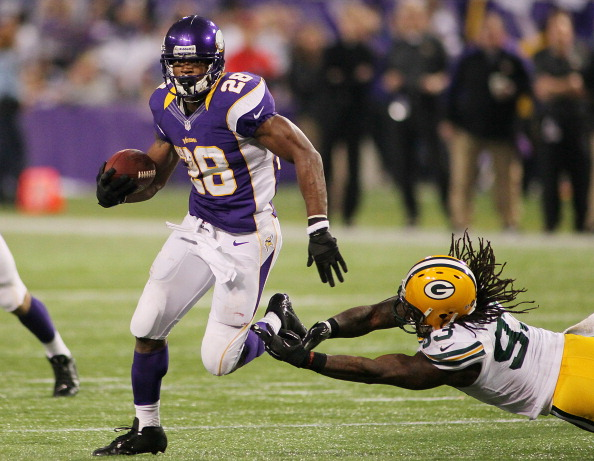MINNEAPOLIS, MN - DECEMBER 30: Adrian Peterson #28 of the Minnesota Vikings runs against the Erik Walden #93 of the Green Bay Packers on December 30, 2012 at Mall of America Field at the Hubert H. Humphrey Metrodome in Minneapolis, Minnesota. (Photo by Andy Clayton King/Getty Images)