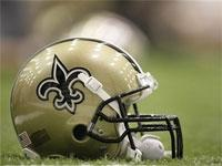 A helmet sits on the field at the New Orleans Saints football practice at their facility in Metairie.