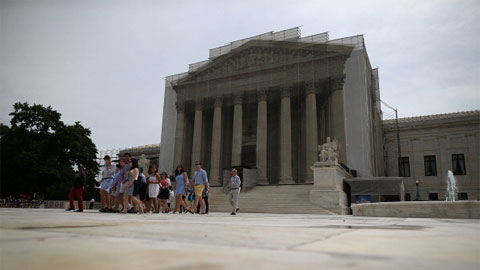 People walk out of the U.S. Supreme Court building June 13, 2013 in Washington, DC.