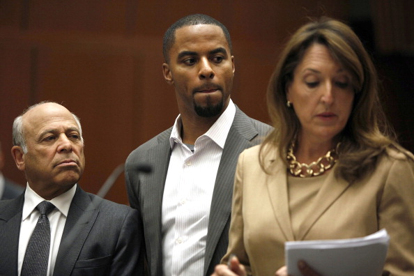 LOS ANGELES, CA - FEBRUARY 14: Former pro football player Darren Sharper appears in court along with his attorneys Blair Berk (R) and Leonard Levine (L) on February 14, 2014 in Los Angeles, California. Sharper was charged today with drugging and raping two woman, one in October and the other last month, the Los Angeles County District Attorney's Office announced. (Photo by Liz O. Baylen-Pool/Getty Images)