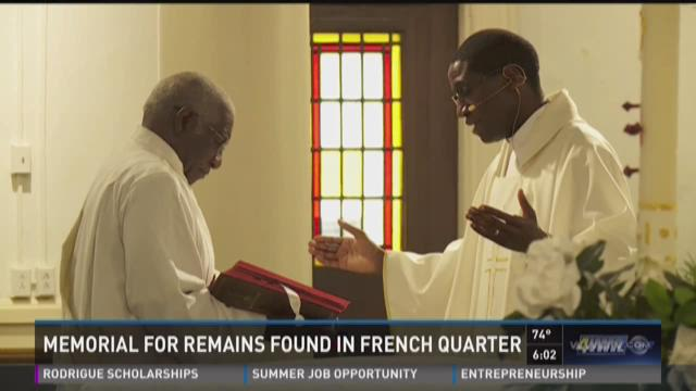 A memorial mass was held in Treme honoring the remains of 15 people connected to the very first days of New Orleans, Antwan Harris explains.
