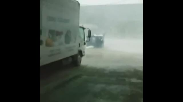 Dumpster gets moved by wind