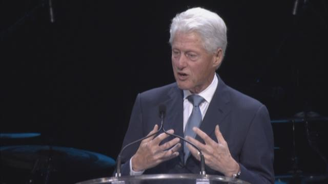 Bill Clinton addresses the crowd at Katrina 10-year commemoration event at the Smoothie King Center.